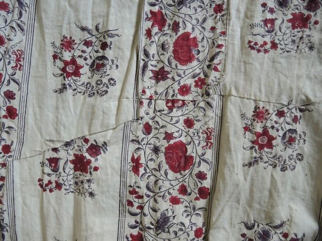 Long tear on back of skirt before conservation