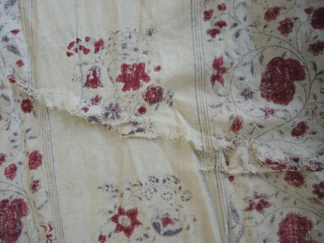 Reverse of long tear showing the rough stitched repairs. This stitching was cut and removed.