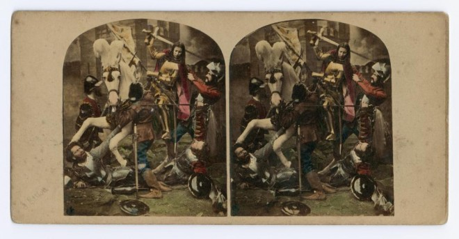 Coloured stereocard entiteld 'Joan of Arc taken Prisoner' depicting a re-enactment of Joan of Arc on a white horse fighting several men, by James Elliott, London