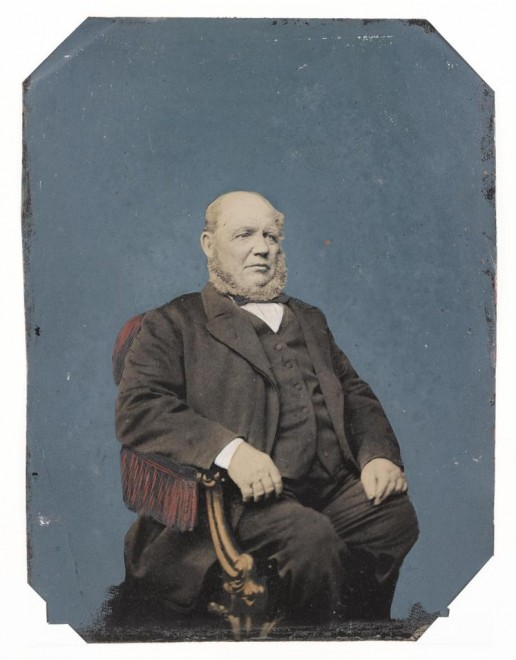 Whole plate heavily tinted tintype, depicting a seated man,mounted, by an unknown photographer, 1870s - 1890s