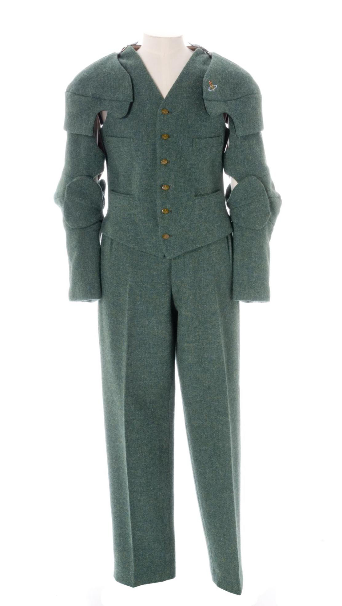 Men's suit of green wool Harris tweed from the Western Isles, designed by Vivienne Westwood for her Time Machine Collection, London, A/W 1988.
