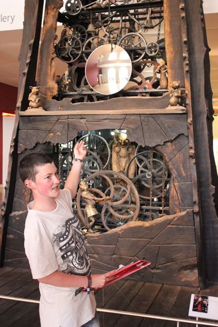 Young Demonstrator Caitlyn discussing the Millennium Clock.