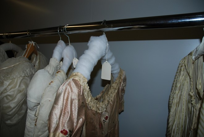 Before volunteer intervention: an example of old 'padded' hangers which do not provide the correct support and are not covered with smooth cotton stockinette.