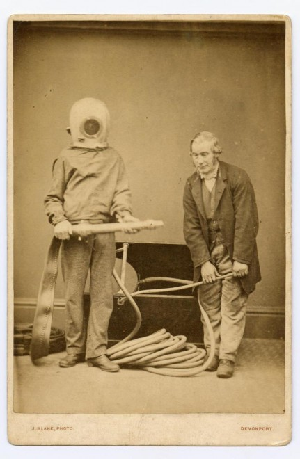 Cabinet portrait depicting two men, one wearing a firefighters' 'smoke apparatus' and holding a hose, by J Blake, Devonport. From the Howarth-Loomes collection at National Museums Scotland