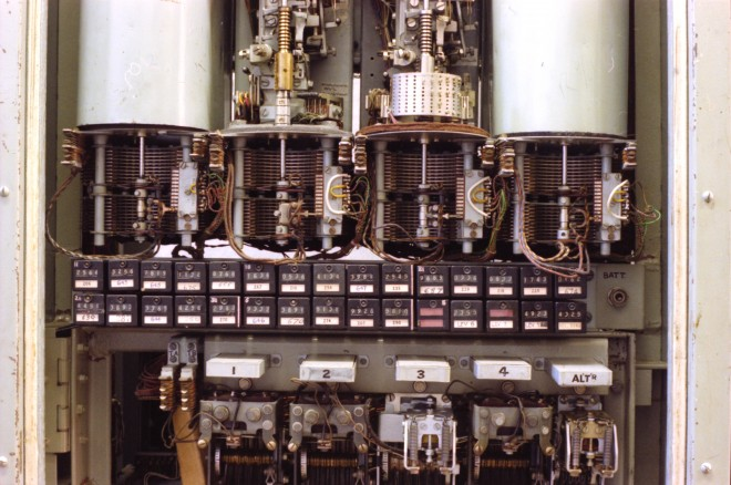 A bank of original subscribers' meters at Kildrummy exchange, also showing some 'pre-2000 type' electromechanical selectors.