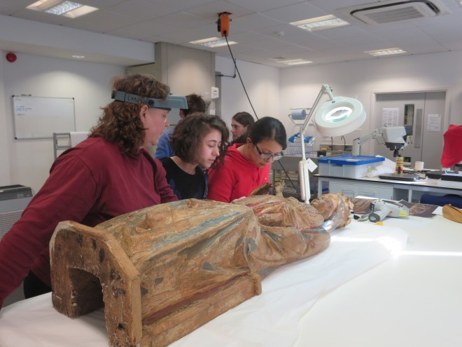 Dr Ticca Ogilvie and students from the University of Glasgow inspect the Madonna in the lab at National Museums Collections Centre