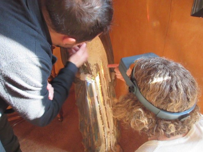 Luca and Diana discuss the paint layers on the cloak of the Virgin and the carving underlying them