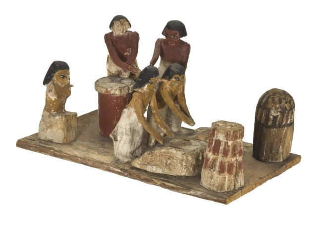 A wooden tomb model of a bakery from Beni Hassan, Egypt [A.1914.71].