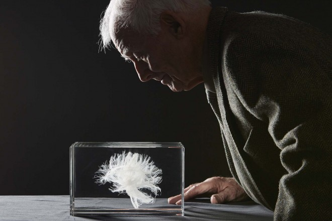 John examines the laser-etched crystal model of his white matter.