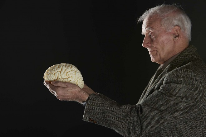 John Scott holds a 3d-printed model of his own brain