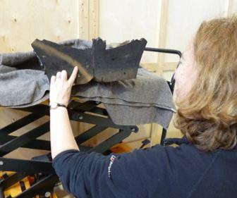 Dendrochronologist Dr Coralie Mills examines an oak capital from the drawing room