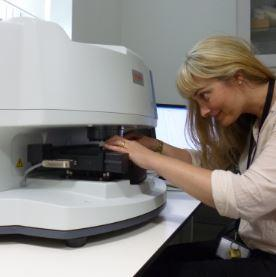 Julia Robinson preparing samples and undertaking FTIR for identification of wood species and applied coatings