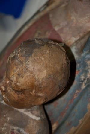 Large brown area of fill material on the Christ Child's head