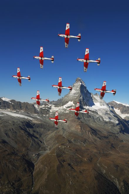Swiss Air Force PC-7 team in formation over The Alps © Swiss Department of Defence, Public Defence and Sport DDPS