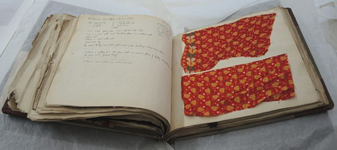 The display page before the book and textiles have been conserved.
