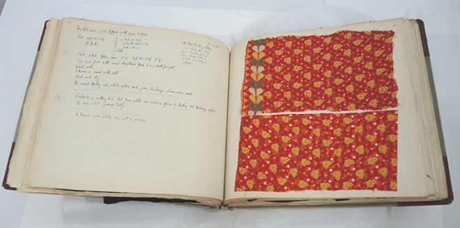 The display page after the book and textiles have been conserved.