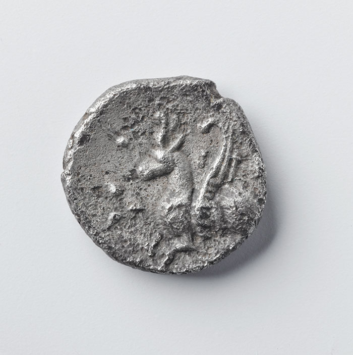 A south-east English late Iron Age silver coin showing a winged horse with a horned cap
