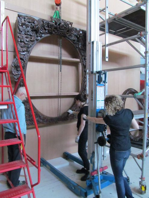 The overmantel being dismantled at the Collection Centre and the wall packed ready for transport to the new galleries.