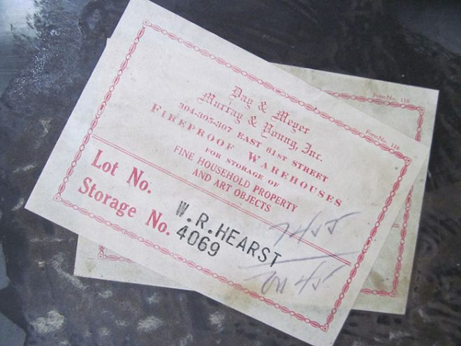An original auction label still affixed to the marble fireplace.
