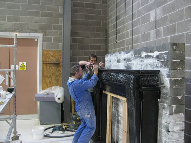 Derren Rose and Simon Ebb of Skillingtons put finishing touches to the trial build of the fireplace.