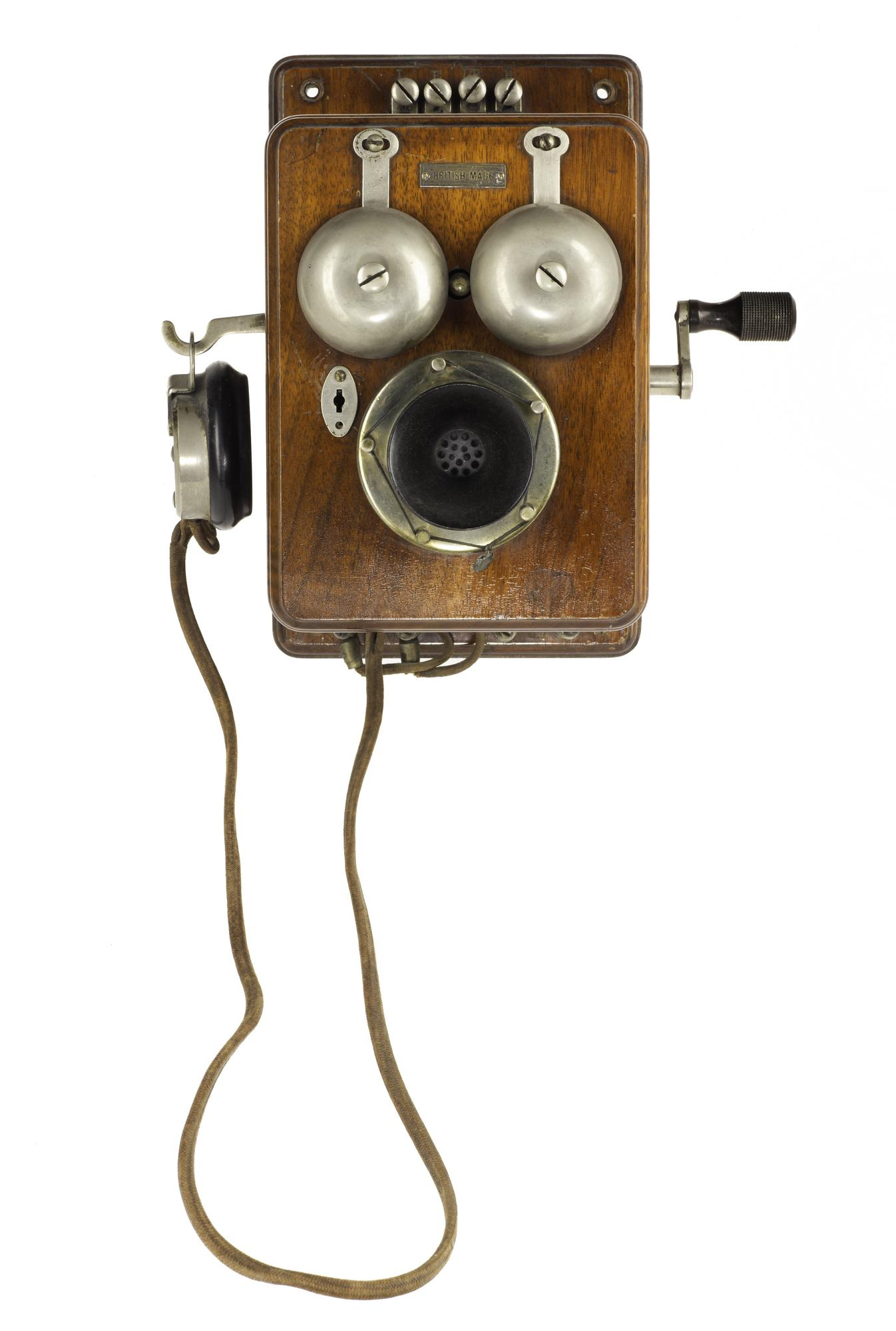 Telephone wall mounting, with a hand-generator, made by Sterling of London, 1905 - 1910