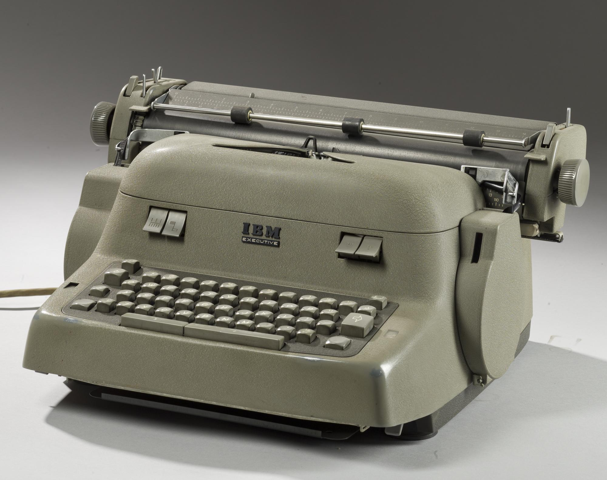 'Executive' electric typewriter with bold-face type and dull grey crackle finish, by I.B.M., 1957