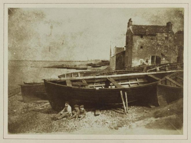 Salt print depicting Newhaven beach with wooden boats, from a volume of salt prints by David Octavius Hill and Robert Adamson, 1843 - 1847, presented to the Society of Antiquaries of Scotland by D.O. Hill, RSA, 10 March 1851.