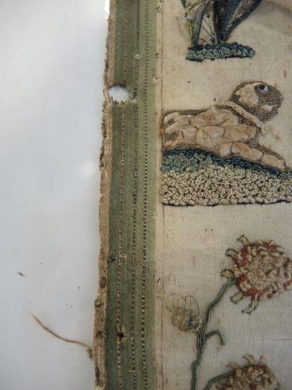 The left edge of the sampler after conservation treatment.