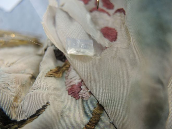 Agarose gel block placed on underarm of bodice with visible wetting of silk fabric.
