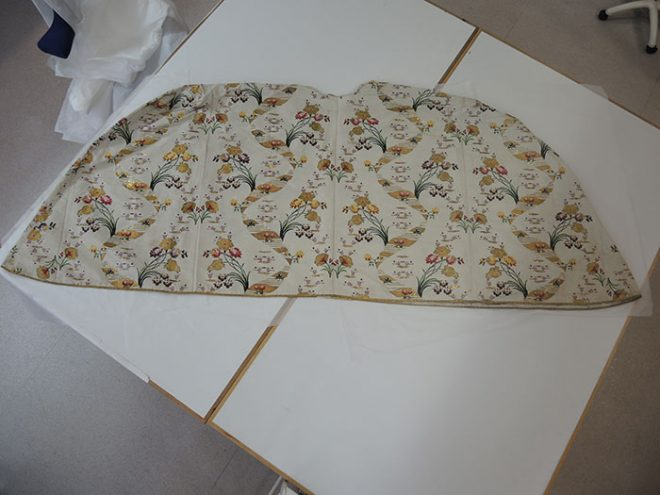 Petticoat laid out on two work tables.