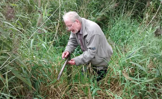 Richard Tipping examining a core through peat and loch sediments