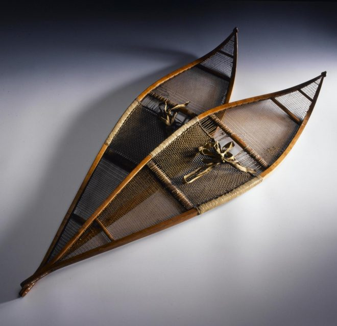 Pointed snowshoe of wood netted with fine strips of hide, made and used in the winter of 1851 by Dr John Rae during his Arctic exploration.