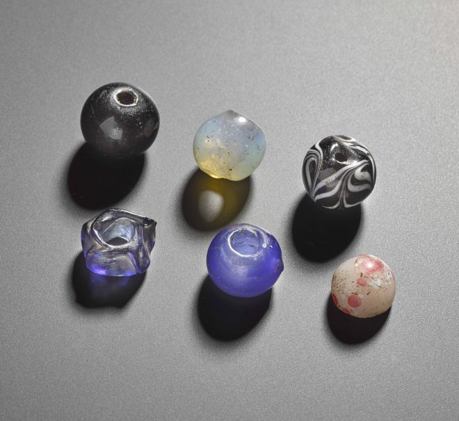 Six beads of recent date bought … in March 1900.