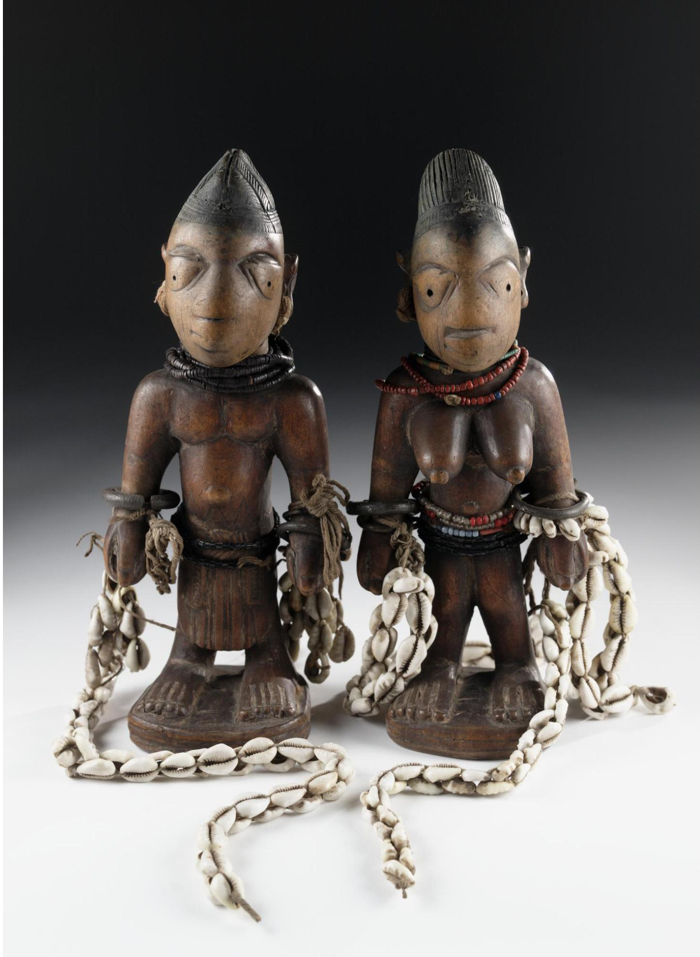 Carved wooden ere ibeji figures, Africa, West Africa, south-western Nigeria, Yoruba, late 19th or early 20th century.