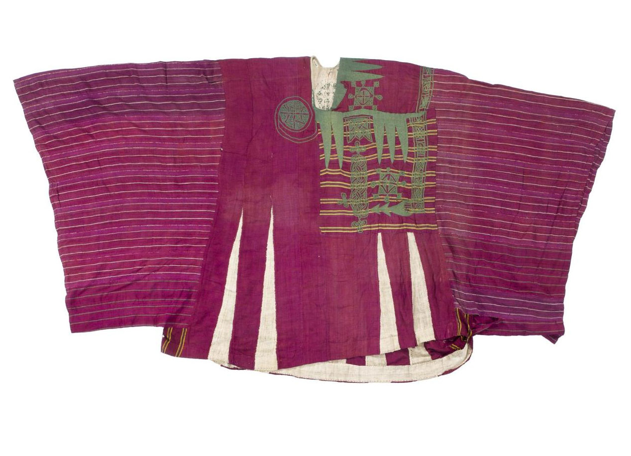 Riga from the African textiles collection, made from crimson cotton striped with white and yellow and elaborately embroidered in green: Northern Nigeria, Hausa.