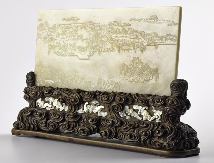 Table screen of pale green jade, engraved on one side with a landscape and on the other with a poem by the Qianlong Emperor, dated 1784, with carved wood stand inlaid with bats in mother-of-pearl: China, Qing Dynasty, Qianlong reign (A.1978.590).