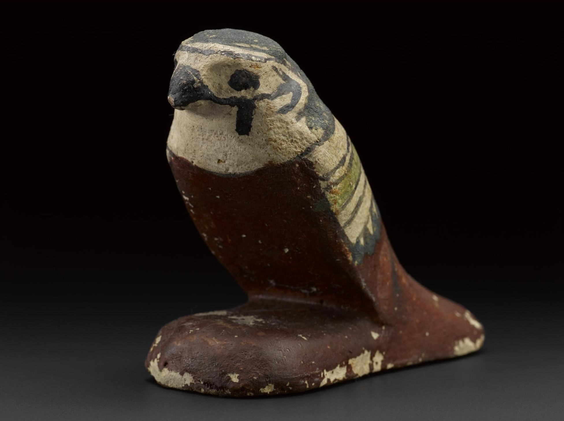 Guardian figure of a mummiform falcon in wood, from the lid of a qrsw-coffin: Sheikh Abd el-Qurna, Thebes, Egypt, c.747–525BC.