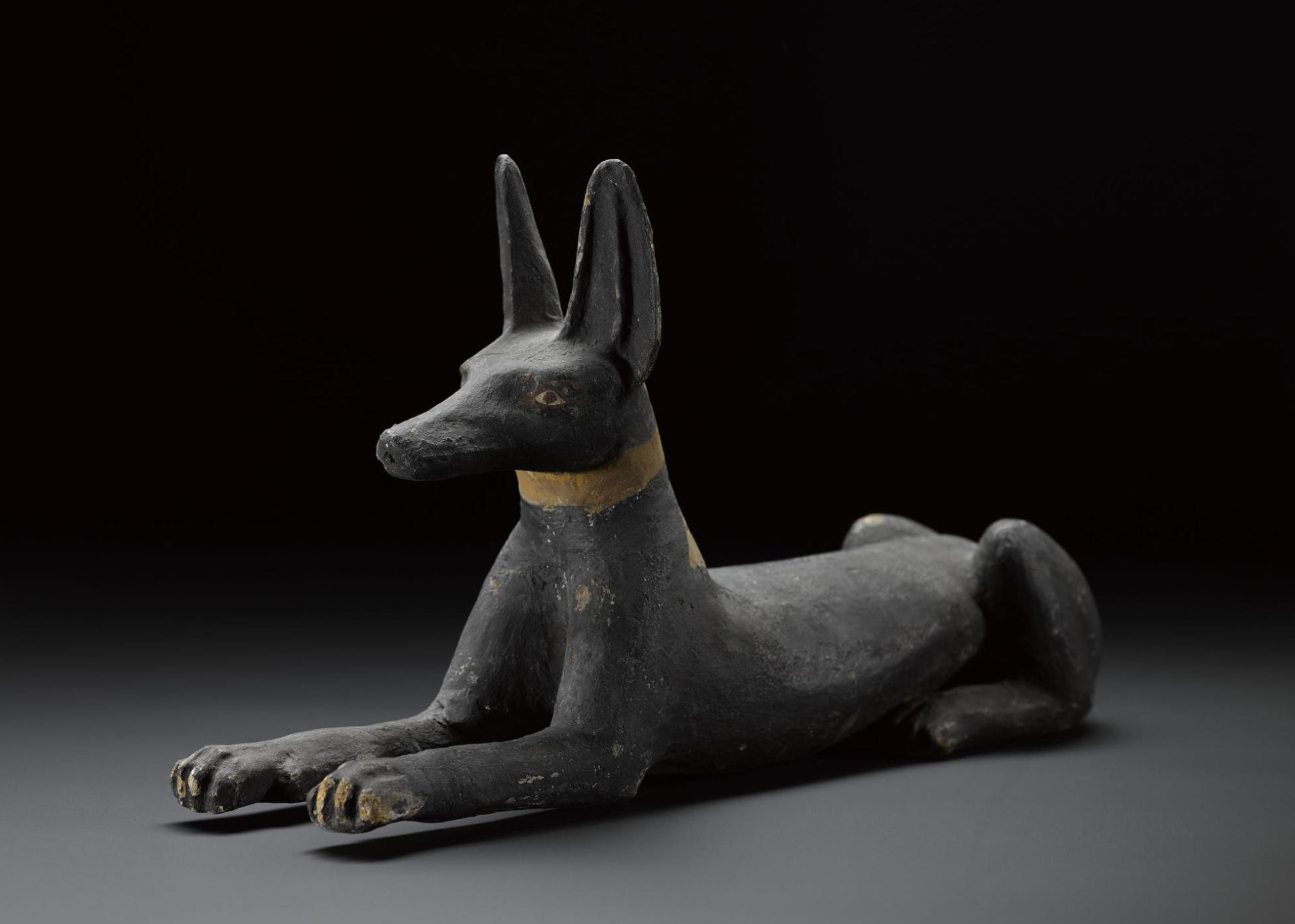 Guardian figure of a jackal in wood, from the lid of a qrsw-coffin: Sheikh Abd el-Qurna, Thebes, Egypt, c.747–525BC.