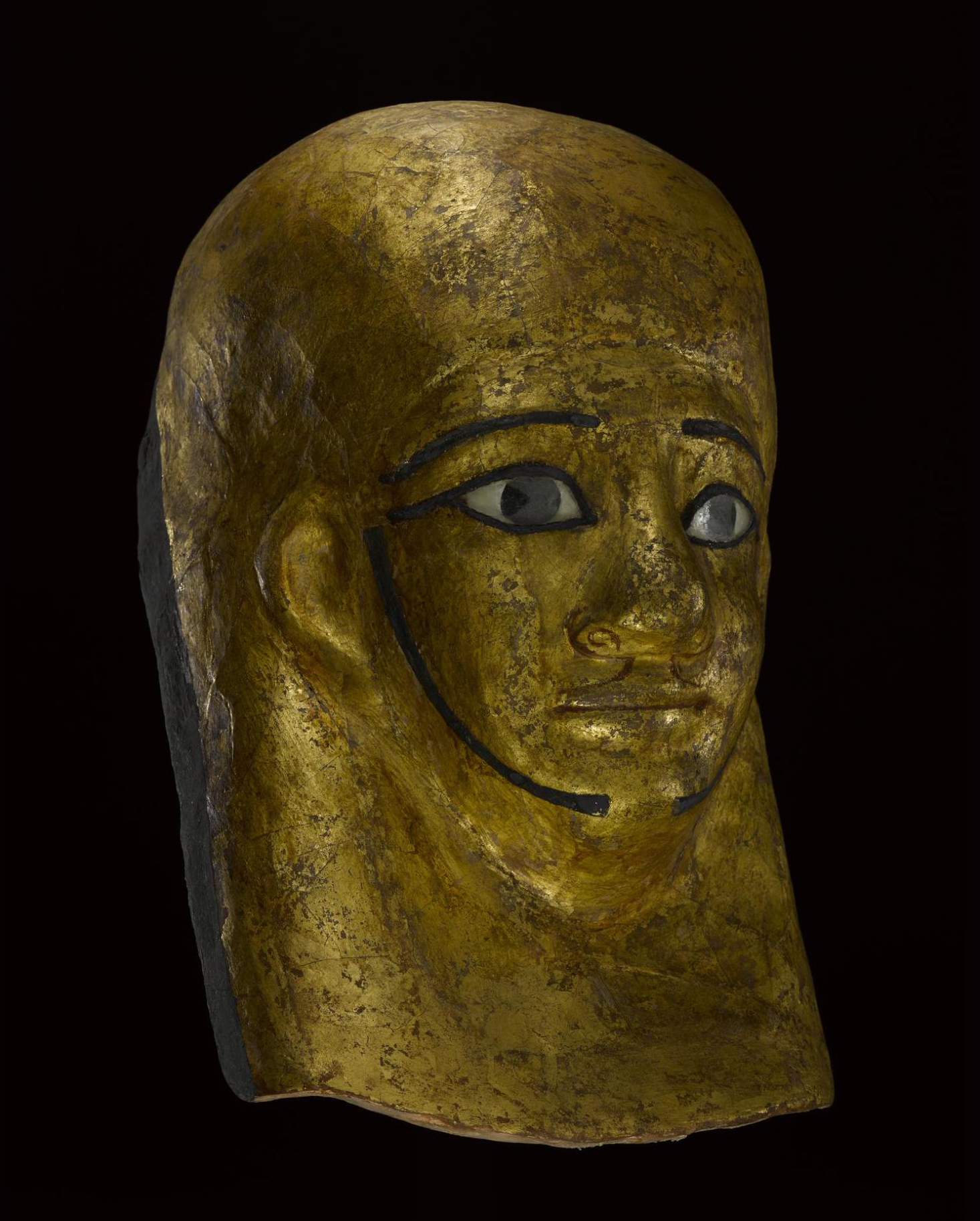 Mummy-mask of gilded and painted linen and plaster cartonnage, depicting the high-official Montsuef: Sheikh Abd el-Qurna, Thebes, 9BC.