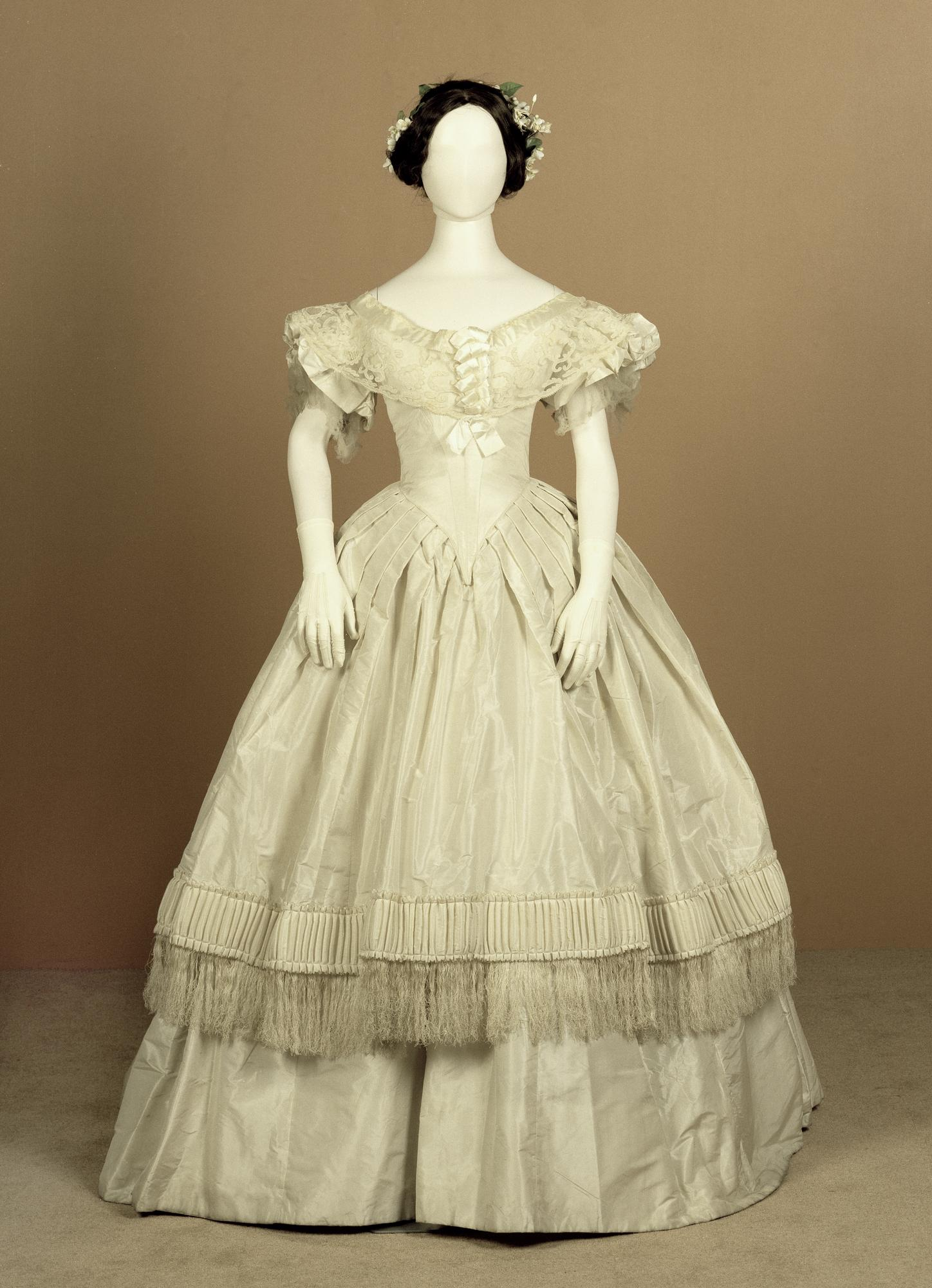 Dress of white silk taffeta trimmed with white silk fringing, part of a woman's evening dress: British, c. 1852 - 1857.
