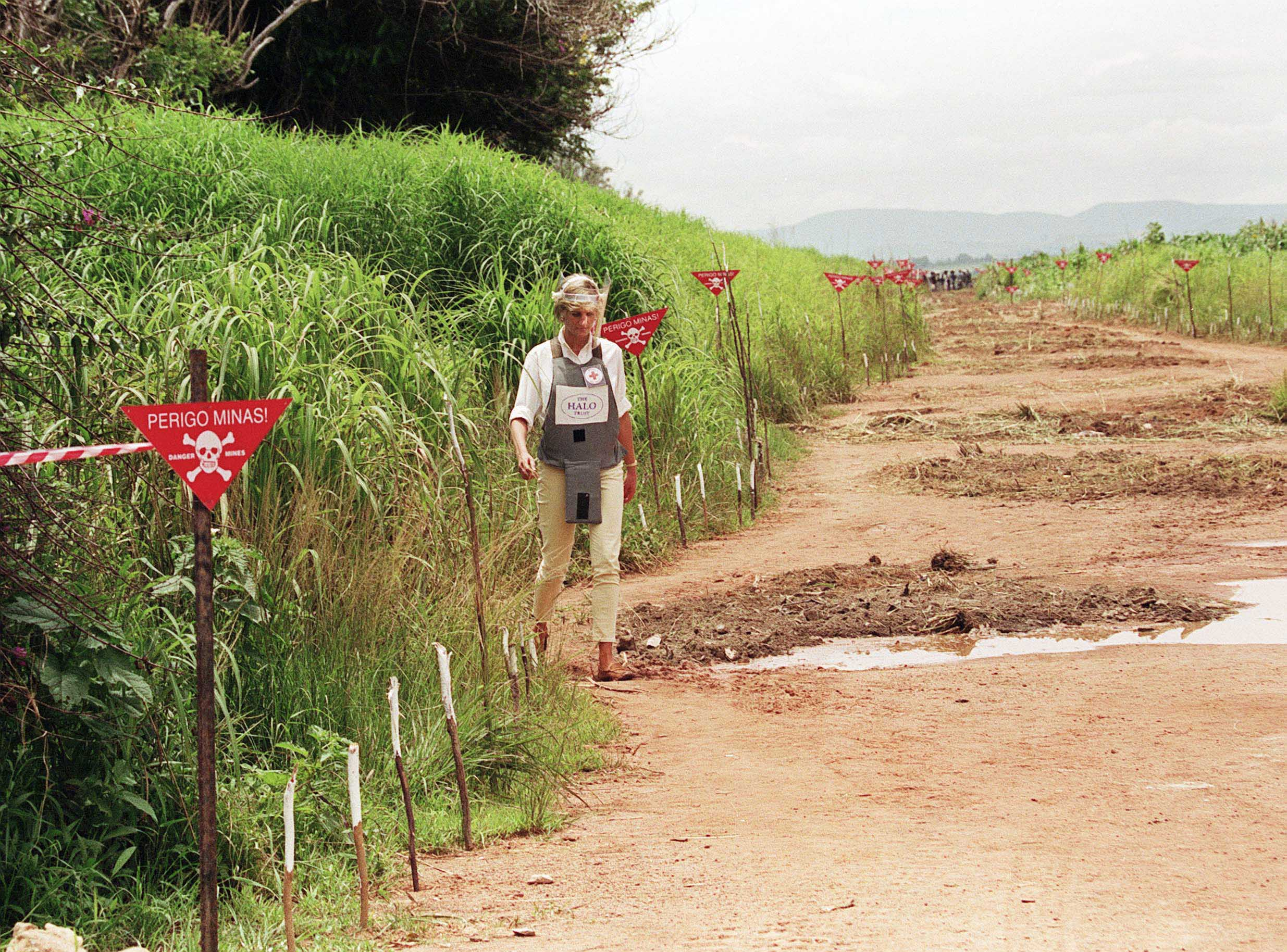 Princess Diana walking through a minefield in Angola to highlight the work of the HALO Trust © Anwar Hussein