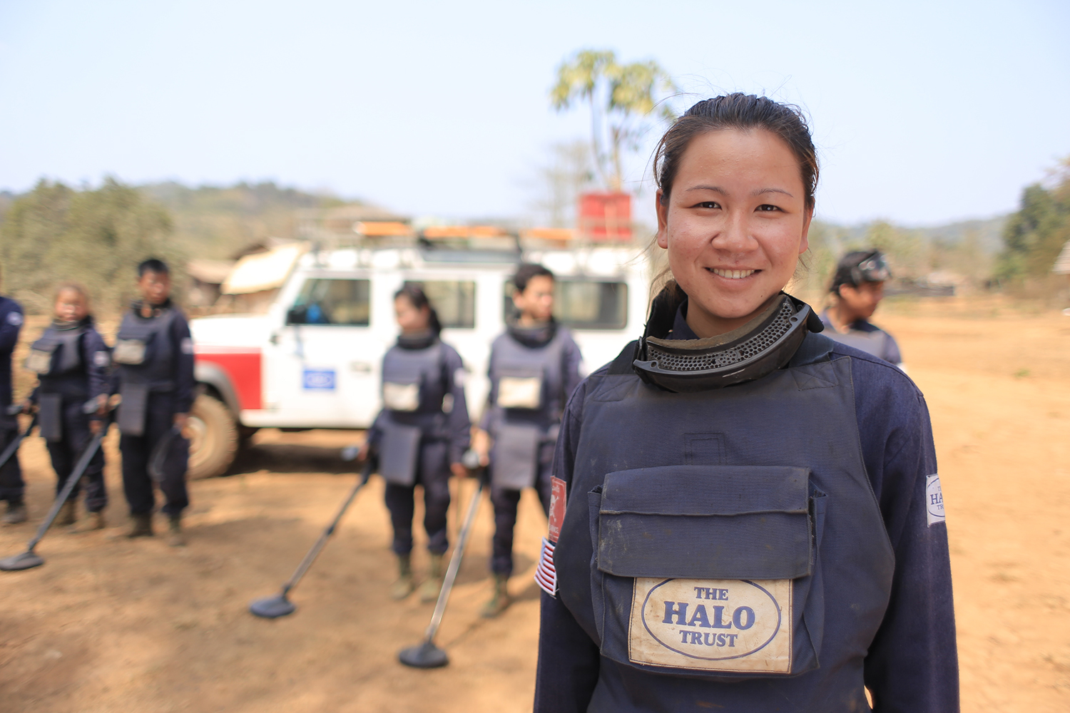 A female deminer working for The HALO Trust in Laos © The HALO Trust.