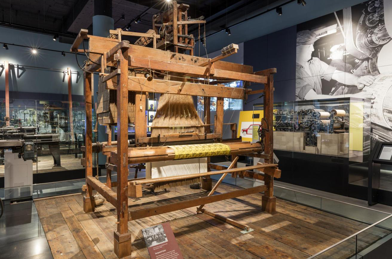 Silk weaving loom with a Jacquard attachment, with a silk scarf on the machine in the process of manufacture, probably made by Joseph Hood of Newmilns, Ayrshire