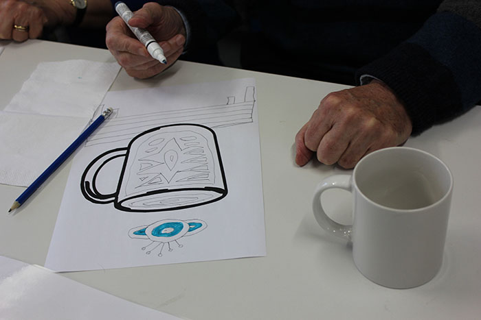 Designing a cup at a Museum Socials session.