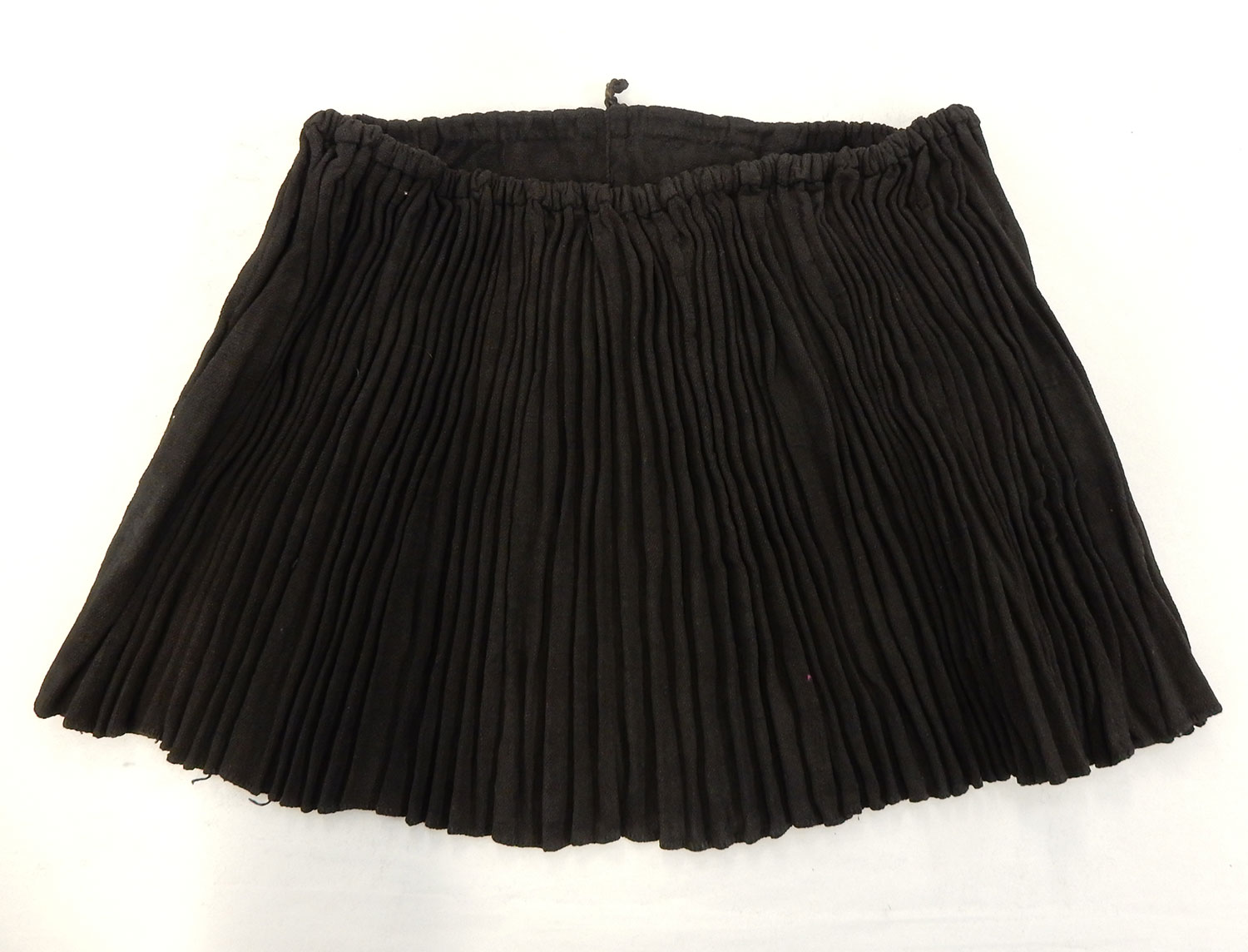 Woman's black cotton pleated skirt: May Wilson collection. Museum reference A.1984.596.1.