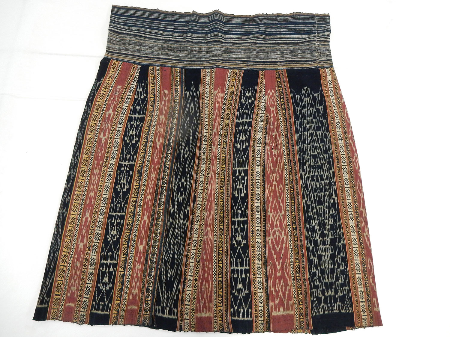 Woman's ankle-length straight wrapover funerary skirt or Pa sin or Sin mi of wool decorated with ikat tie-dyed panels and woven patterns: Asia, South East Asia, North East Laos, Houaphan Province, Sam Neua, Tai, early 20th century. Museum reference A.1995.93.
