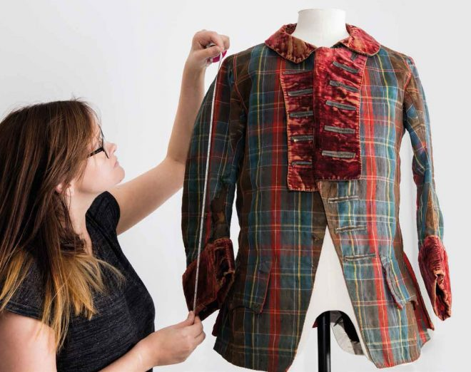 Danielle Connolly with the frock coat that may have belonged to Bonnie Prince Charlie.
