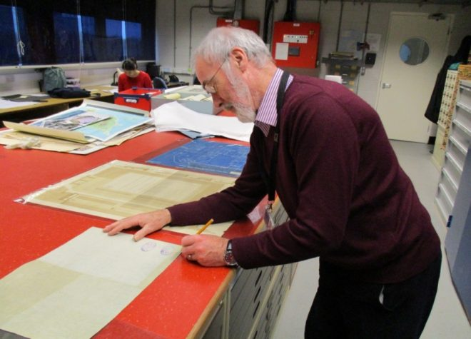 John at work with the drawings at the National Museums Collection Centre.