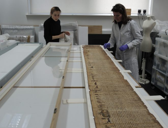 Fig. 10 Collections Services Technician, Sarah Laing and Paper Conservator, Lisa Cumming preparing the front-loading frame.