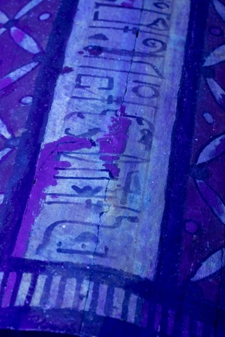Fig. 4 Royal purple patches highlight the localised restoration of the inscription.